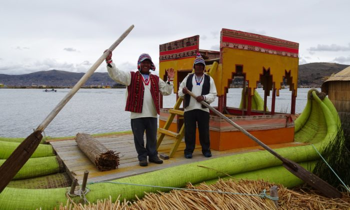 touring Peru men rowing boat