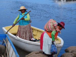 touring peru woman on boat